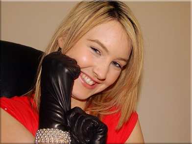 Girl putting on leather gloves